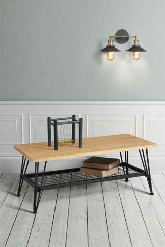 An Image of Felix Industrial Coffee Table - Solid oak and steel