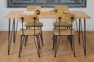 An Image of Felix Industrial Dining Table / Desk - Solid oak and steel
