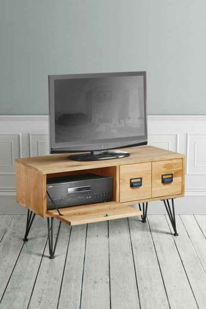 An Image of Felix Industrial Media Unit - Solid oak and steel