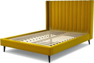 An Image of Custom MADE Cory King size Bed, Saffron Yellow Velvet with Black Stained Oak Legs