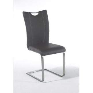 An Image of Pavo Swinging Grey Faux Leather Dining Chair With Handle Hole