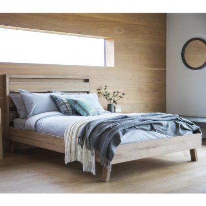 An Image of Kielder Mellow Solid Oak King Size Bed In Light Oak
