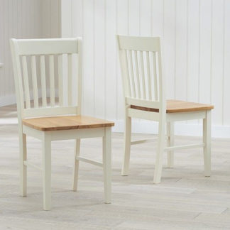 An Image of Fornax Wooden Oak And Cream Dining Chairs In Pair
