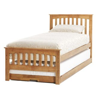 An Image of Amelia Hevea Wooden Single Bed And Guest Bed In Honey Oak