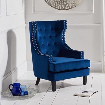 An Image of Irina Modern Accent Chair In Blue Velvet With Black Legs