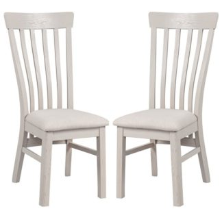 An Image of Leanne Wooden Dining Chairs In Stone Washed White In A Pair