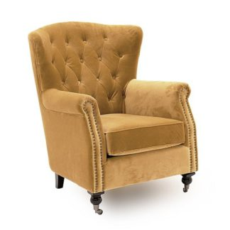 An Image of Reedy Velvet Wingback Chair In Mustard With Metal Castor