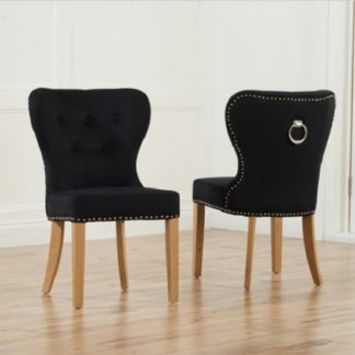 An Image of Wallace Dining Chair In Black Velvet With Oak Legs In A Pair