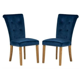 An Image of Wodan Velvet Dining Chair In Blue With Oak Legs In A Pair