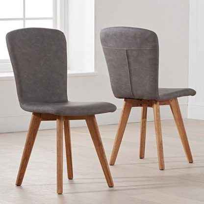 An Image of Nembus Grey Faux Leather Dining Chairs In Pair