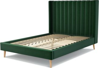 An Image of Custom MADE Cory Double size Bed, Bottle Green Velvet with Oak Legs