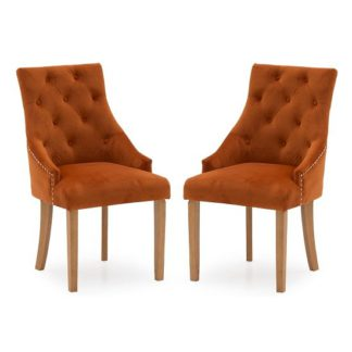 An Image of Vanille Velvet Dining Chair In Pumpkin With Oak Legs In A Pair