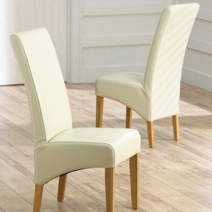 An Image of Choe Cream Bonded Leather Dining Chairs With Oak Legs In A Pair