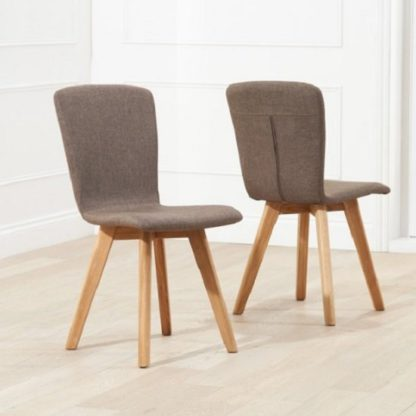 An Image of Javelin Dining Chairs In Brown Fabric In A Pair