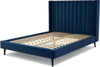 An Image of Custom MADE Cory King size Bed, Regal Blue Velvet with Black Stained Oak Legs