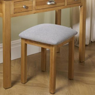 An Image of Woburn Wooden Stool In Oak With Fabric Seat
