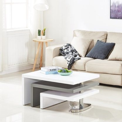 An Image of Design Rotating Coffee Table In White And Grey High Gloss