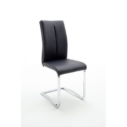 An Image of Tavis Metal Swinging Black Faux Leather Dining Chair