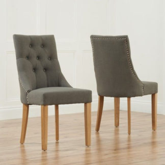 An Image of Anser Grey Dining Chairs In Pair With Solid Oak Legs