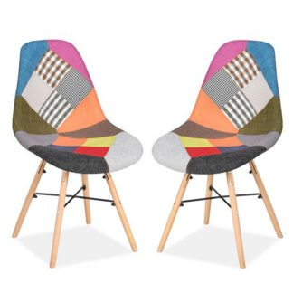 An Image of Breuer Dining Chairs In Patched With Wooden Legs In A Pair