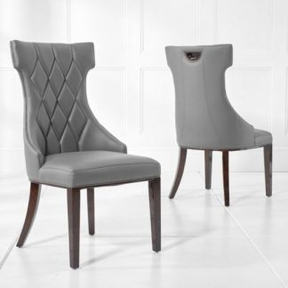 An Image of Tybrook Grey Faux Leather Dining Chair With Wood Legs In A Pair