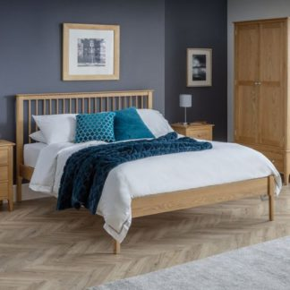 An Image of Cotswold Wooden King Size Bed In Oak