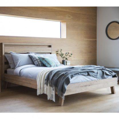 An Image of Kielder Mellow Solid Oak Double Bed In Light Oak