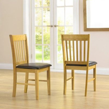 An Image of Fornax Solid Hardwood Dining Chairs In Pair