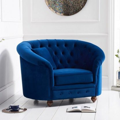 An Image of Astoria Sofa Chair In Blue Plush Fabric With Wooden Legs