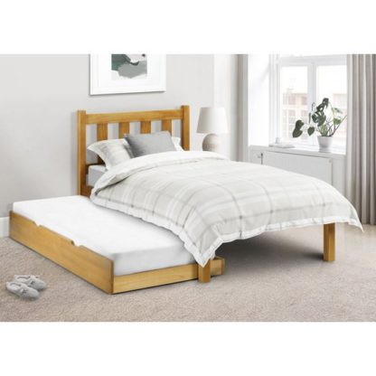 An Image of Poppy Solid Pine Double Bed And Guest Bed In Low Sheen Lacquer