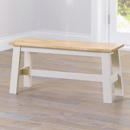 An Image of Antlia Wooden Small Dining Bench In Oak And Cream