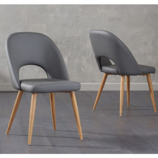 An Image of Heze Grey Faux Leather Dining Chairs In Pair