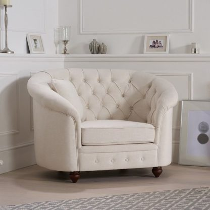 An Image of Astoria Chesterfield Sofa Chair In Ivory Fabric With Wooden Legs
