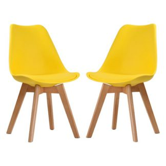 An Image of Louvre Yellow Finish Dining Chairs In Pair