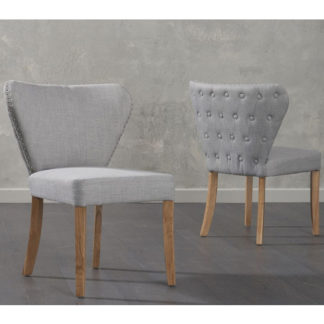 An Image of Nervia Grey Fabric Dining Chairs In Pair