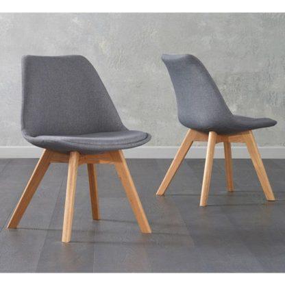 An Image of Brachium Dark Grey Fabric Dining Chairs In Pair