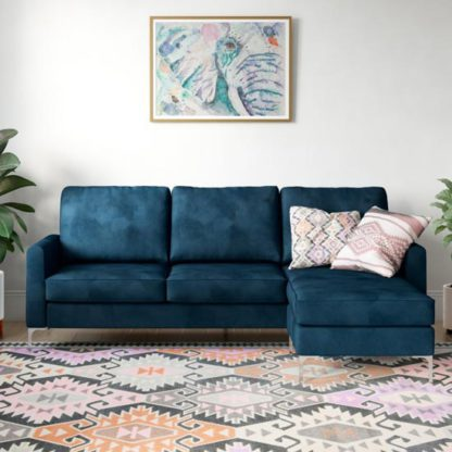 An Image of Chapman Velvet Corner Sofa In Blue with Chrome Legs