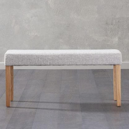 An Image of Miram Small Grey Soft Fabric Dining Bench With Solid Oak Legs