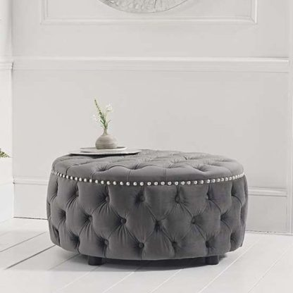 An Image of Aniara Velvet Round Footstool In Grey