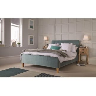 An Image of Marciel Fabric King Size Bed In Aqua Velvet With Wooden Legs