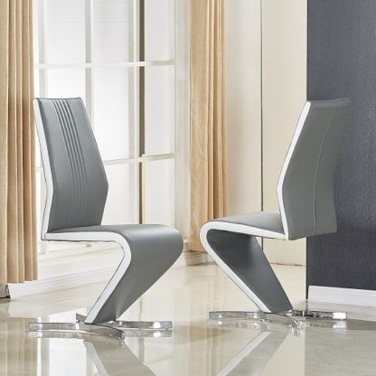 An Image of Gia Dining Chair In Grey And White Faux Leather In A Pair