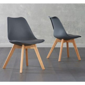 An Image of Brachium Dark Grey Faux Leather Dining Chairs In Pair