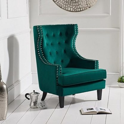 An Image of Irina Modern Accent Chair In Green Velvet With Black Legs
