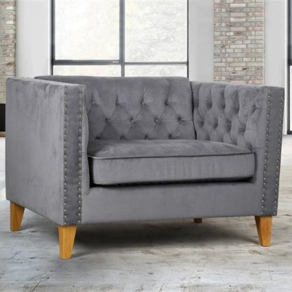 An Image of Atherton Fabric Sofa Chair In Grey Velvet With Wooden Legs