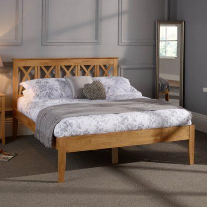 An Image of Autumn Hevea Wooden Double Bed In Honey Oak