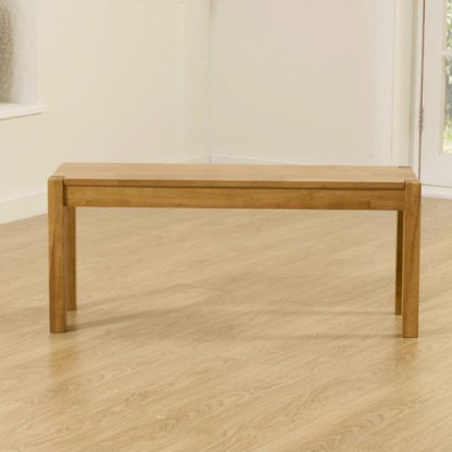 An Image of Elnath Medium Dining Bench In Solid Oak