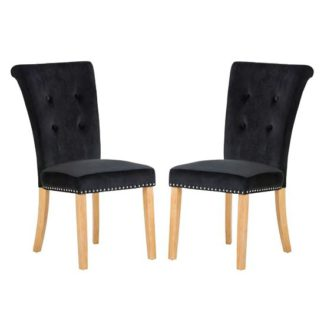 An Image of Wodan Velvet Dining Chair In Black With Oak Legs In A Pair