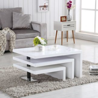 An Image of Design Coffee Table Rotating In White High Gloss With 3 Tops