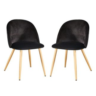 An Image of Swart Velvet Dining Chairs In Black With Oak Legs In A Pair