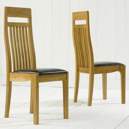 An Image of Pollux Dining Chairs In Pair With Black Leather Seat